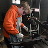 Tabor Washburn hammers a piece of steel during a blacksmith class at Autry Technology Center Saturday March 10, 2018. (Billy Hefton / Enid News & Eagle)