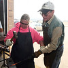 Jim Carothers gives instruction to Brandy Washburn during a blacksmith class at Autry Technology Center Saturday March 10, 2018. (Billy Hefton / Enid News & Eagle)