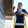 Marquette University student, Hong Ding, paints a house for Habitat for Humanity Wednesday March 14, 2018. (Billy Hefton / Enid News & Eagle)