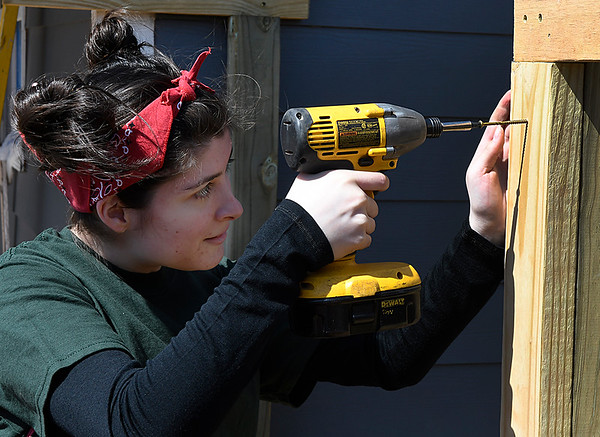 Marquette University student, Jordan Moll, works on a fence at a Habitat for Humanity house Wednesday March 14, 2018. (Billy Hefton / Enid News & Eagle)