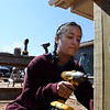 Marquette University student, Valeria Castro, works on a fence at a Habitat for Humanity house Wednesday March 14, 2018. (Billy Hefton / Enid News & Eagle)