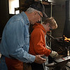 Tom Nelson gives instruction to Tabor Washburn during a blacksmith class at Autry Technology Center Saturday March 10, 2018. (Billy Hefton / Enid News & Eagle)