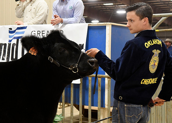 Drake Williams, of Cherokee, shows his grand champion steer during the premium sale of the 85th Northwest District Junior Livestock Show Monday March 11, 2019 at the Chisholm Trail Expo Center. (Billy Hefton / Enid News & Eagle)
