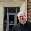 Fr. Mark Mason stands outside St. Joseph Catholic School following an interview at St. Francis Xavier Catholic Church Friday March 22, 2019. (Billy Hefton / Enid News & Eagle)