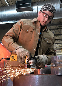 Brayan Hernandez, from Covington-Douglas High School, uses a grinder during welding class at Autry Technology Center Monday March 4, 2019. (Billy Hefton / Enid News & Eagle)
