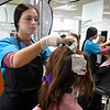 Tori Gosney, from Chisholm High School, styles hair on a mannequin during cosmetology at Autry Technology Class Monday March 4, 2019. (Billy Hefton / Enid News & Eagle)