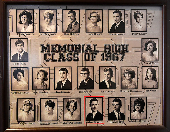 Fr. Mark Mason's gradulating class photo that hangs in a hallway at St. Joseph Catholic School Friday March 22, 2019. (Billy Hefton / Enid News & Eagle)