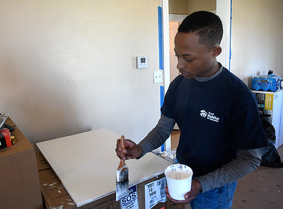 Marquette University student, Jamal Hanson, paints while working for Habitat for Humanity Tuesday, March 10, 2020. (Billy Hefton / Enid News & Eagle)