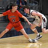 Pawnee's Gunnar Gordon looks for an opening against Pioneer's Koby Vestal during the Area 1 tournament at Stride Bank Center Thursday, March 5, 2020. (Billy Hefton / Enid News & Eagle)