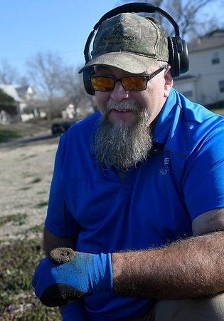 Brian Terrell shows a brass ornament he found while metal detecting Tuesday, March 10, 2020. (Billy Hefton / Enid News & Eagle)