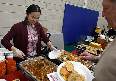 Noeme Hodges serves gumbo at the Commons, Panevino's and Youngblood Grille during Rotary's Festival of Flavor Tuesday, March 10, 2020 at Prairie View Elementary. (Billy Hefton / Enid News & Eagle)