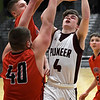 Pioneer's TY Dennett shoots against Pawnee during the Area 1 tournament at Stride Bank Center Thursday, March 5, 2020. (Billy Hefton / Enid News & Eagle)