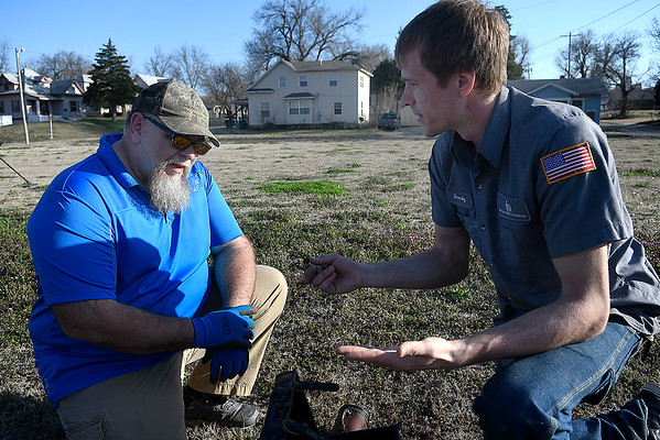 Brian Terrell and Rowdy Coffee discuss items previously found while metal detecting. (Billy Hefton / Enid News & Eagle)
