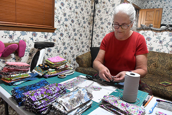 Kathy Ring works on making facial mask at her home Friday, March 27, 2020. (Billy Hefton / Enid News & Eagle)