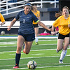 Enid's Edith Vega gets around Midwest City defenders to score Tuesday, March 3, 2020 at D. Bruce Selby Stadium. (Billy Hefton / Enid News & Eagle)