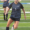 Enid's Taylor Schlecht dribbles the ball against Midwest City March 3, 2020 at D. Bruce Selby Stadium. (Billy Hefton / Enid News & Eagle)