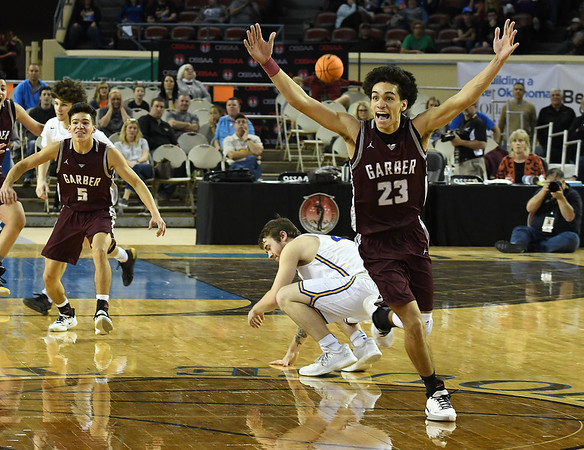 Garber's Daegan Vandiver celebrates  as the final second run off the clock  in Garber's 53-51 double overtime win over Arapho-Butler in the Class A state championship Saturday, March 7, 2020 at the State Fair Arena in Oklahoma City. (Billy Hefton / Enid News & Eagle)