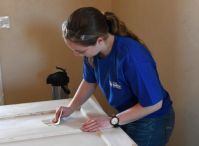 Marquette University student, Clare Herrig, sands a door while working for Habitat for Humanity Tuesday, March 10, 2020. (Billy Hefton / Enid News & Eagle)