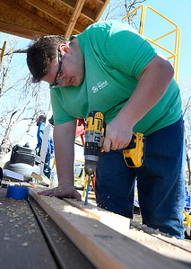 Marquette University student, Alex Gross, Works on a railing at a Habitat for Humanity house Tuesday, March 10, 2020. (Billy Hefton / Enid News & Eagle)