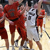 Pioneer's Cal Dennett puts up a shot against Pawnee's Trent Hixon during the Area 1 tournament at Stride Bank Center Thursday, March 5, 2020. (Billy Hefton / Enid News & Eagle)