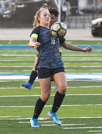 Enid's Marissa Neil gains control of the ball against Midwest City March 3, 2020 at D. Bruce Selby Stadium. (Billy Hefton / Enid News & Eagle)