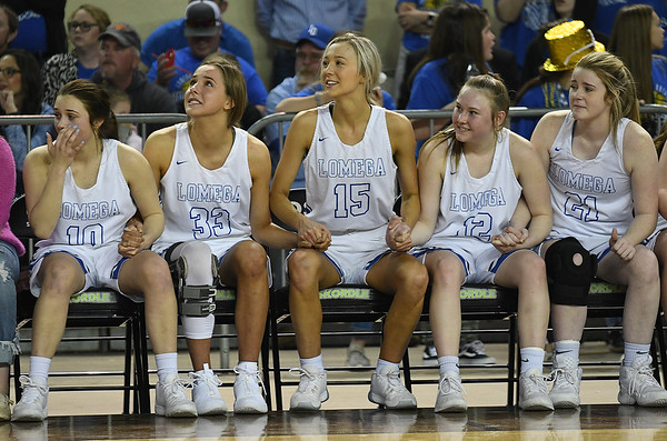 Lomega's Hensley Eaton, Emma Duffy, Ady Wilson, Shelby Russell and Reagan Ramer hold hands as the final second tick off the clock in their win over Varnum in the Class B state championship game Saturday, March 7, 2020 at the State Fair Arena in Oklahoma City. (Billy Hefton / Enid News & Eagle)