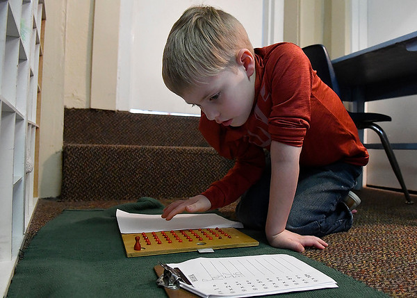 Cimarron Montessori kindergartener, Ryker Treadwell,  works on multiplication Tuesday, March 3, 2020. (Billy Hefton / Enid News & Eagle)