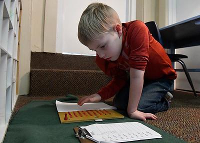 Cimarron Montessori kindergartener, Ryker Treadwell,  works on multiplication Tuesday, March 3, 2020. (Billy Hefton / Enid News & Eagle)