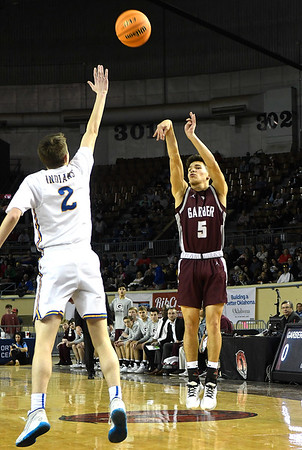 Garber's T.J. Bennett shoots over Arapho-Butler's Brett Griffith in the Class A state championship Saturday, March 7, 2020 at the State Fair Arena in Oklahoma City. (Billy Hefton / Enid News & Eagle)