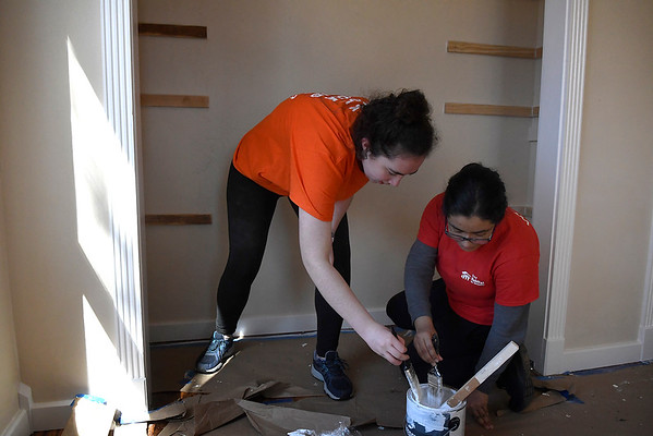 Marquette University students, Meggie Griffin and Ximena Vera, paint a closet while working for Habitat for Humanity Tuesday, March 10, 2020. (Billy Hefton / Enid News & Eagle)