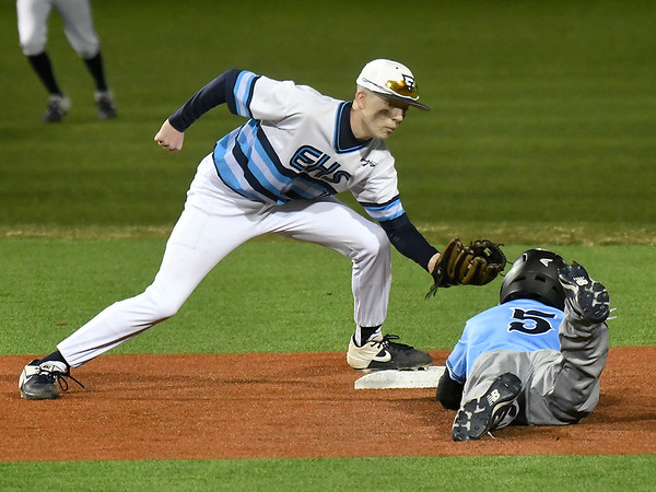 Enid's Kade Goeke tags out Bartlesville's Bradee Rigdon during the home opener Monday March 2, 2020 at David Allen Memorial Ballpark. (Billy Hefton / Enid News & Eagle)