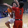 Pioneer's Kevin Noel up a shot against Pawnee's Landreth Harrison during the Area 1 tournament at Stride Bank Center Thursday, March 5, 2020. (Billy Hefton / Enid News & Eagle)