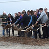 Dirt gets tossed into the air as 4RKids held a groundbreaking ceremony on a new 2.2 million dollar building Friday, March 13, 2020. (Billy Hefton / Enid News & Eagle)