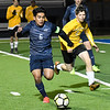 Enid's Brayan Rodriguez outrun Midwest City defenders to the ball Tuesday, March 3, 2020 at D. Bruce Selby Stadium. (Billy Hefton / Enid News & Eagle)