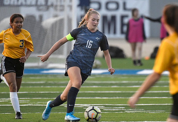 Enid's Marissa Neil dribbles through Midwest City defenders Tuesday, March 3, 2020 at D. Bruce Selby Stadium. (Billy Hefton / Enid News & Eagle)