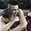 Garber's Taye Sullivan hugs Jordan Anson follwing their 53-51 double overtine win over Arapho-Butler in the Class A state championship Saturday, March 7, 2020 at the State Fair Arena in Oklahoma City. (Billy Hefton / Enid News & Eagle)