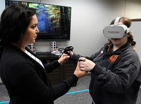 Rafaela Avila (left) assist Mikalyn Stuber int he VR lab at NWOSU Enid Monday, March 3, 2020. (Billy Hefton / Enid News & Eagle)