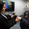 Rafaela Avila (left) assist Mikalyn Stuber int he VR lab at NWOSU Enid Monday, March 3, 2020. (Billy Hefton / Enid News & Eagle)