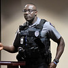 Enid police officer, Christian Owusu, says a few words after recieving and award from Dr. Richard DeVaughn for being named Police Officer of the Year. (Billy Hefton / Enid News & Eagle)