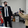 Rep. Denise Crosswhite Hader takes a photo of Gov. Kevin Stitt and Wayne Ediger Friday, March 12, 2021 at the new 4RKids facility. (Billy Hefton / Enid News & Eagle)