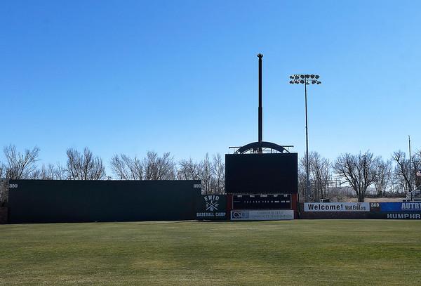 A crane sets the new scorebord at David Allen Memorial Ballpark into place Wednesday, February 3, 2021. (Billy Hefton / Enid News & Eagle)