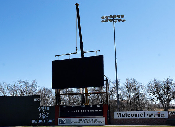 A crane lowers the new scorebord at David Allen Memorial Ballpark into place Wednesday, February 3, 2021. (Billy Hefton / Enid News & Eagle)