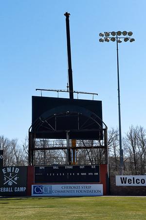 A crane lifts the new scorebord at David Allen Memorial Ballpark into place Wednesday, February 3, 2021. (Billy Hefton / Enid News & Eagle)