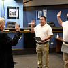 Judge James Long swears in new Enid police officers, Neal Storey and Kevin Hart, Wednesday, March 24, 2021 at Enid City Hall. (Billy Hefton / Enid News & Eagle)