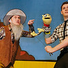 "Chandler Jackson (right) operates Mr. Puppet as he rehearses a scene with Daniel Johnson in the Gaslight Theatre production of ""Mr. Puppet"" Wednesday March 2, 2016. (Billy Hefton / Enid News & Eagle)"