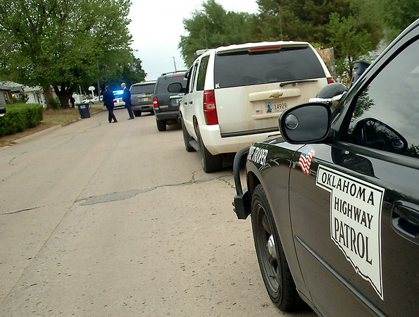 Oklahoma Highway Patrol; Oklahoma Bureau of Narcotics; State Police; Enid Police Department and Garfield County Sheriff Department were among the agencies that assisted during the large-scale drug sweep in Enid, Fairview and Oklahoma City Thursday, May 8, 2014. (Staff Photo by BONNIE VCULEK)