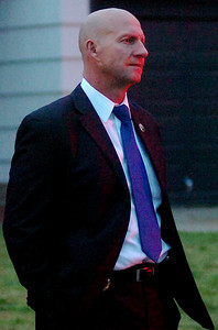 Darrell Weaver, Director of the Oklahoma Bureau of Narcotics, stands across the street from an Enid residence where individuals were arrested during a large-scale drug sweep Thursday, May 8, 2014. (Staff Photo by BONNIE VCULEK)