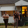 Officers from the Garfield County Sheriff Department, Oklahoma Highway Patrol, Oklahoma Bureau of Narcotics, State Police and Enid Police Department conduct a drug sweep Thursday, May 8, 2014. (Staff Photo by BONNIE VCULEK)