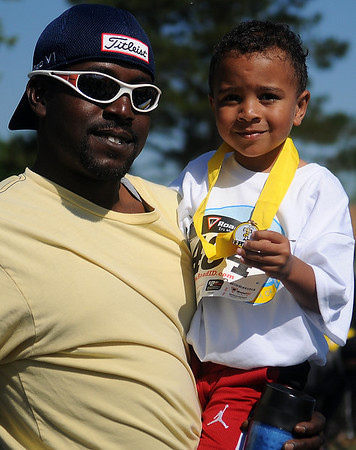 Paul Porter and his son, Javon, at the Be Fit Kids Buzz Run Saturday, May 11, 2013. (Staff Photo by BONNIE VCULEK)