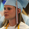 Erin Renee Norrie listens to her classmates Valedictorian addresses during the Chisholm High School Commencement in the Paul J. Outhier Field House Friday, May 10, 2013. (Staff Photo by BONNIE VCULEK)